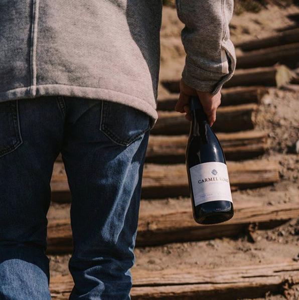 Walking uphill with bottle of wine